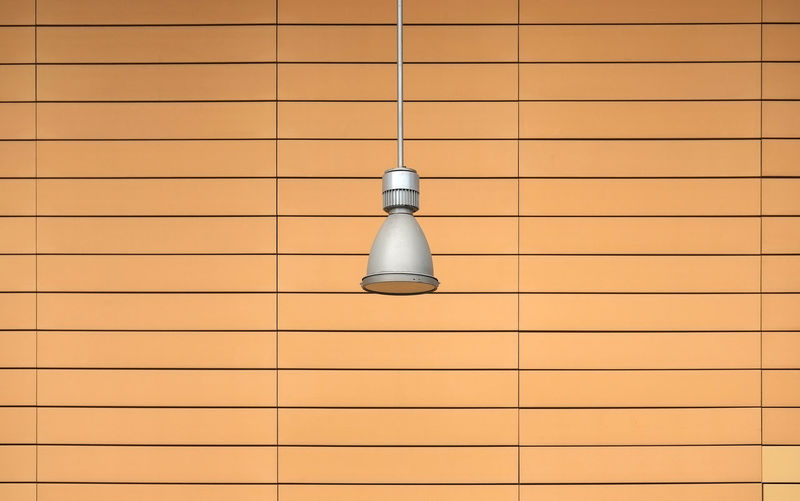 Pendant Lamp Hanging Against Patterned Wall