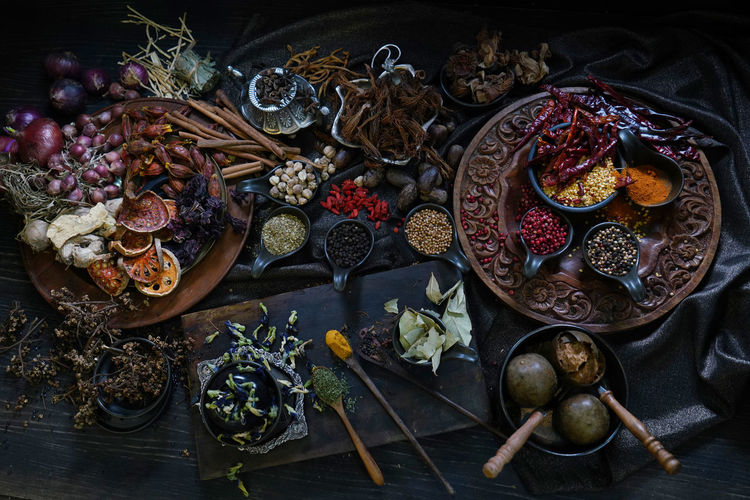 A variety spices and herbs in wooden bowls, of asians for cooking thai seasonings and herbs