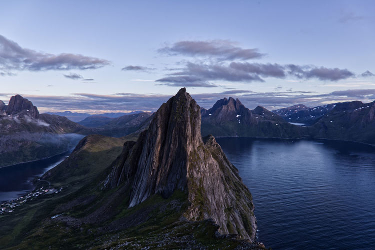 Panoramic view of a fjord and mountains against sky
