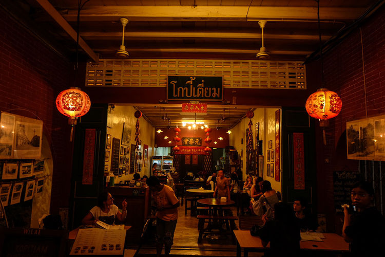 """Chinese House """"KOPITIAM"""" Phuket on Old town Cultures Walking Street Hanging Built Structure Lantern Architecture Illuminated Indoors  City People Day Walking Street Thailand🇹🇭 Astronomy Travel Destinations Phuket,Thailand Crusin' Food And Drink Old Town"""