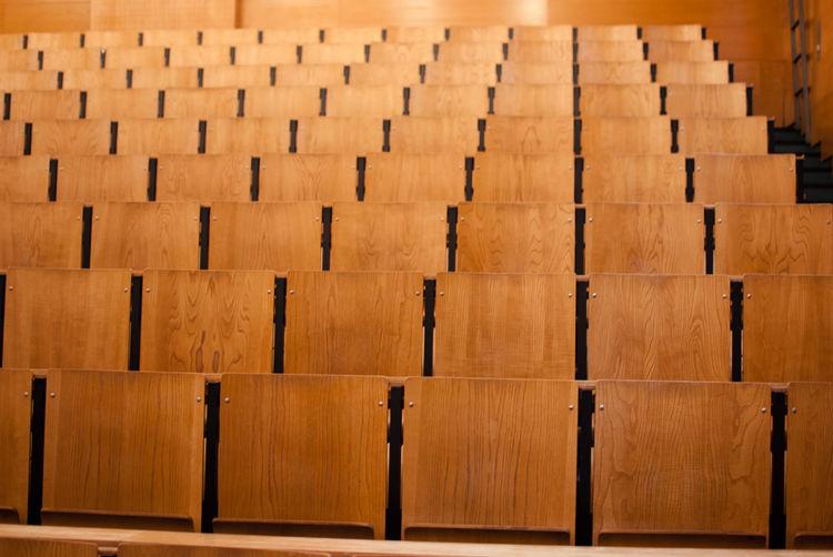 Empty wooden seats in auditorium