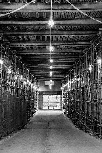 unfinished tunnel ahead Blackandwhite Monochrome Illuminated Lighting Equipment Ceiling Architecture Built Structure Ceiling Light  Light Fixture Recessed Light Underpass Underground Walkway Tunnel Pathway Walkway Fluorescent Light