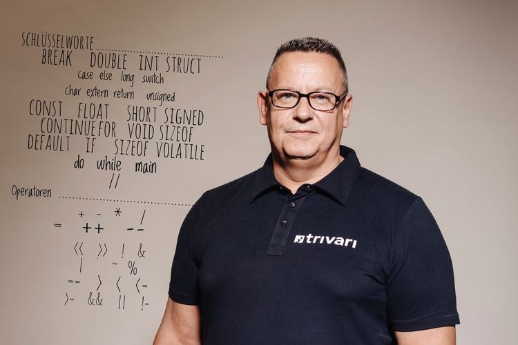 Portrait Of Confident Muscular Man Standing Against Whiteboard