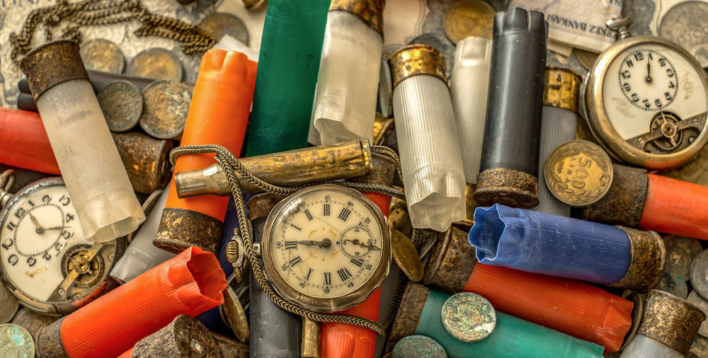Full frame shot of old pocket watches and cartridges