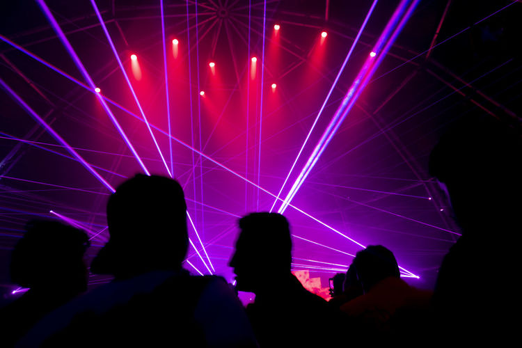 Group Of People Enjoyment Arts Culture And Entertainment Real People Illuminated Nightlife Night Lighting Equipment People Leisure Activity Fun Indoors  Women Men Togetherness Crowd Event Music Lifestyles Light Stage Light Popular Music Concert Positive Emotion Laser Excitement