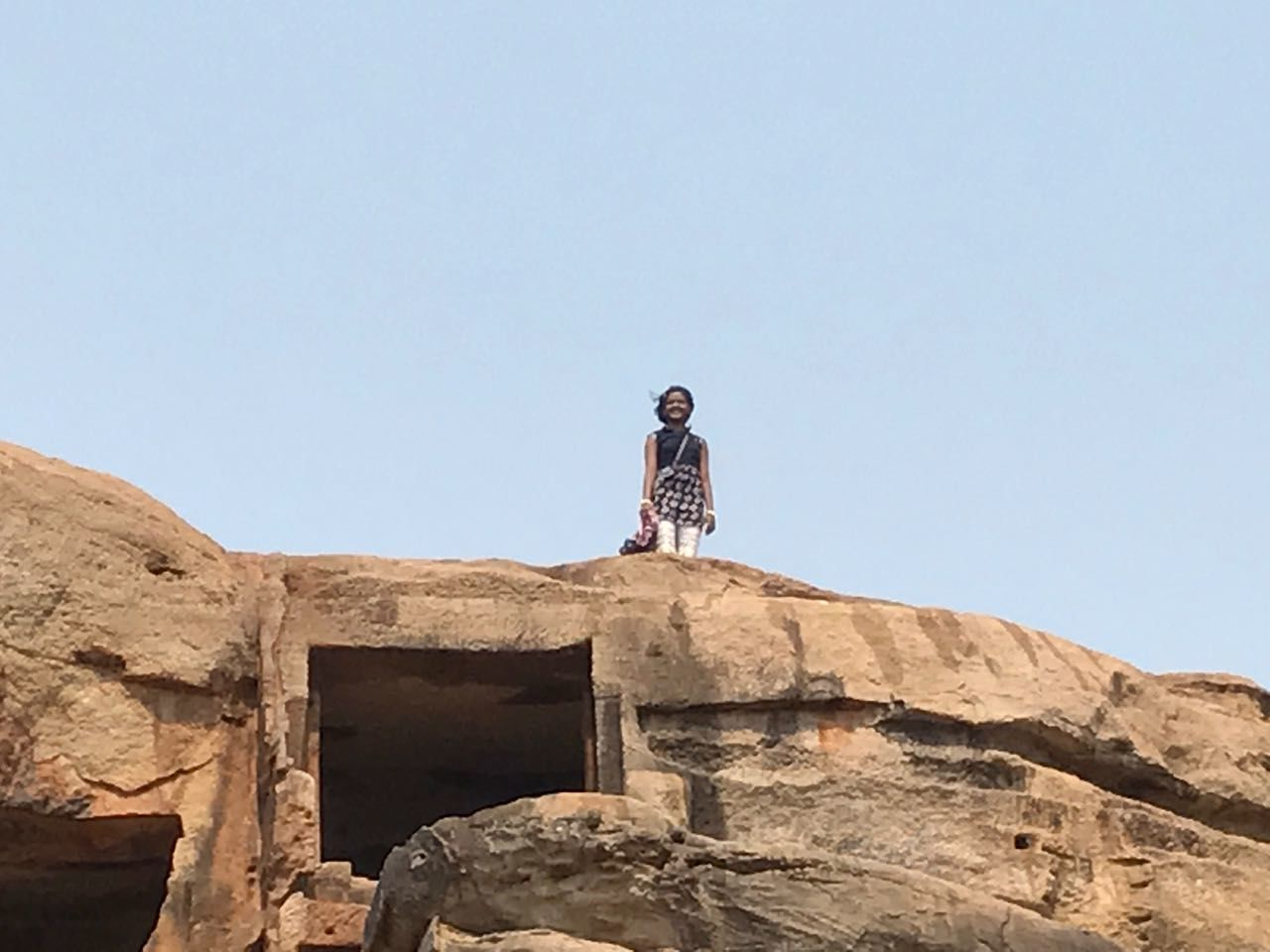 one person, low angle view, standing, young adult, rock - object, clear sky, outdoors, day, architecture, full length, sky, adventure, young women, adult, real people, photograph, people, ancient civilization, nature, adults only