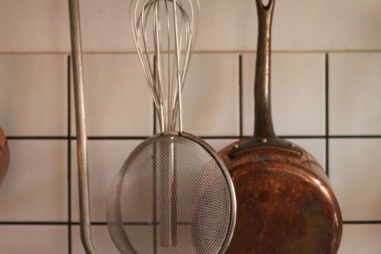 Hanging brass kitchen utensils