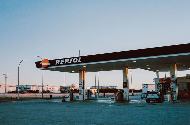 Architecture Built Structure Clear Sky Communication Copy Space Day Filling Fuel And Power Generation Fuel Pump Gas Station Gasoline Nature Outdoors Refueling Sign Sky Station Text Transportation Travel Western Script