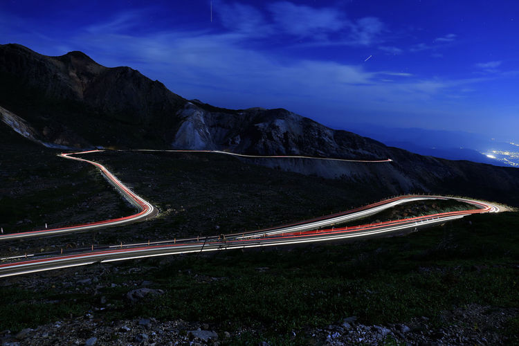 landscape japan fukushima bandaiazuma Beauty In Nature Curve Environment Light Trail Long Exposure Mode Of Transportation Motion Mountain Mountain Range Mountain Road Nature Night No People Non-urban Scene Outdoors Road Scenics - Nature Sky Speed Transportation Winding Road