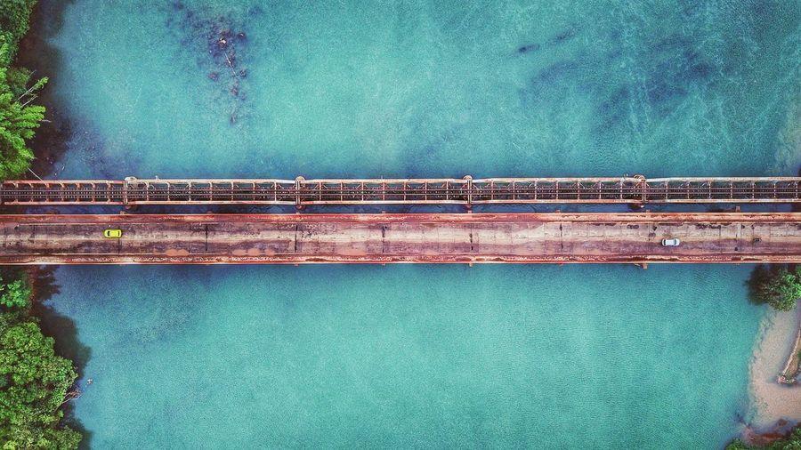 Directly Above Shot Of Bridge Over Sea