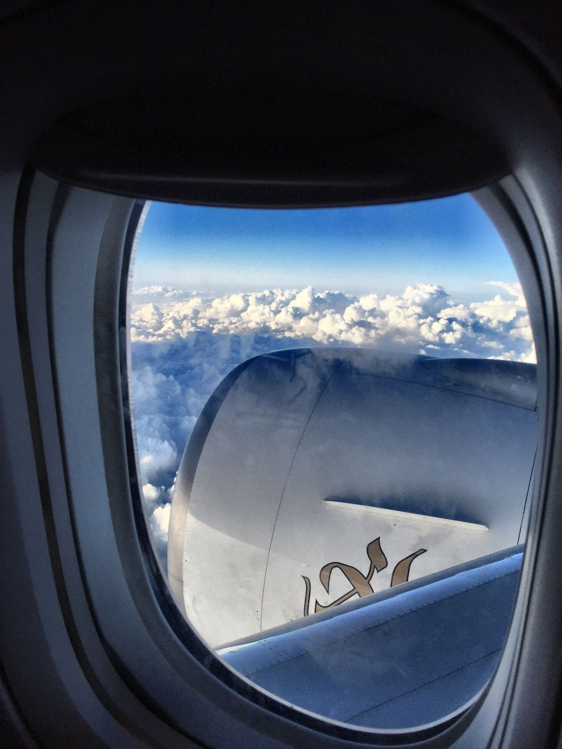 transportation, mode of transport, vehicle interior, air vehicle, airplane, window, glass - material, transparent, land vehicle, sky, travel, car, flying, landscape, part of, journey, vehicle part, on the move, aircraft wing, snow