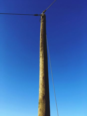 Technology Phoneline Pole Blue Low Angle View Copy Space Clear Sky Day No People Outdoors Hanging Nature Sky Built Structure
