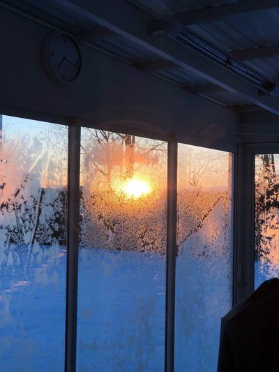 Sunrise EyeEm Early Morning Window Indoors  Sunset No People Architecture Day Cold Temperature Winter Built Structure Sky Snow Nature Close-up