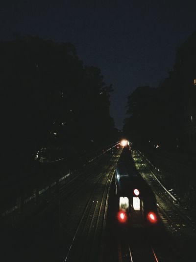 High angle view of train on railroad track at night