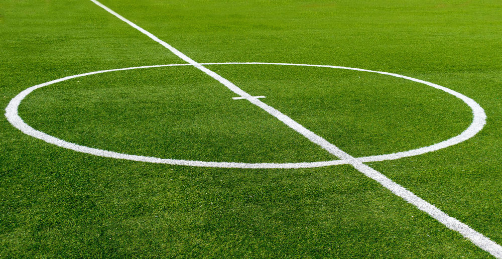 Circle Football Green Green Color Backgrounds Competitive Sport Day Empty Football Field Geometric Shape Grass Green Color No People Outdoors Pattern Playing Field Sport Stadium Team Sport Turf White Color