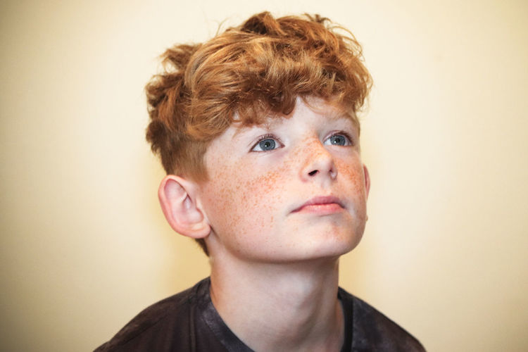 Boy portrait. Children Kids Young Youth Boy Boys Child Childhood Close-up Contemplation Front View Hair Hairstyle Headshot Human Face Indoors  Innocence Kid Looking Males  One Person Portrait Studio Shot Teenager Wall - Building Feature