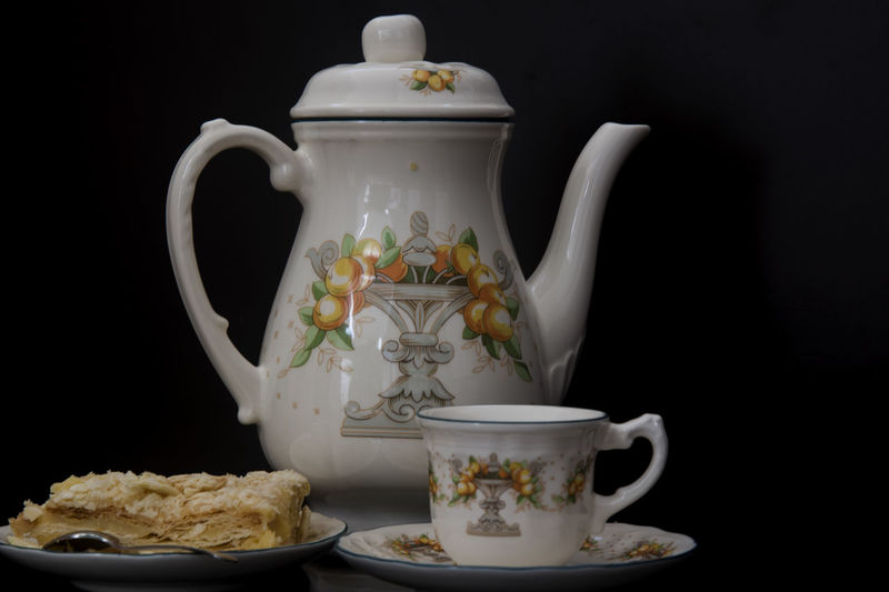 Teapot, cup and