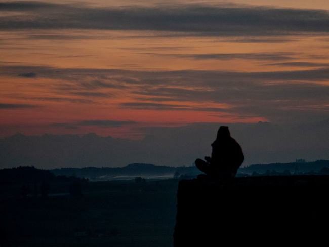 Sunset Sky Silhouette Cloud - Sky One Animal Sitting Orange Color Beauty In Nature Nature Scenics - Nature Mountain Mammal People Lifestyles Vertebrate Leisure Activity Tranquil Scene Landscape
