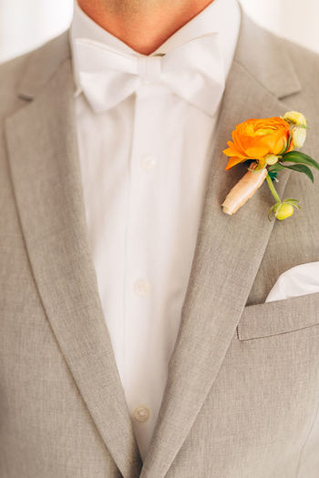 Midsection of man holding flower