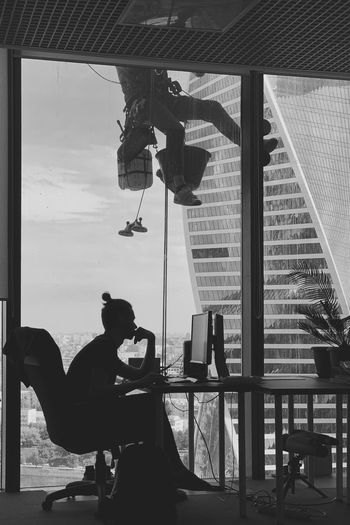 Evening 🙋🏻✨ Blackandwhite IPhoneography Office Building Window View Job Of The Day Skyscrapers Window Washer Working Climber Spiderman Working Hard Work Brave Window Cleaner Real People Window Indoors  Men Day Silhouette Transparent Architecture Lifestyles Occupation Sitting Built Structure Glass - Material The Mobile Photographer - 2019 EyeEm Awards