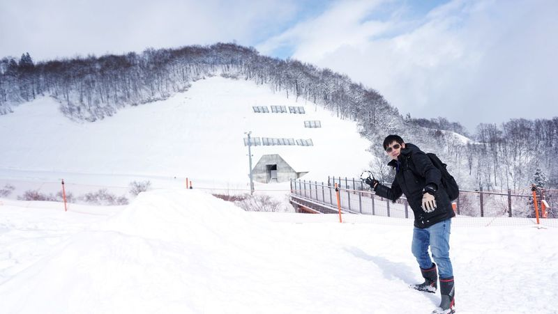 Winter Snowing Freeze Cold Weather Boy Man Childhood Snow Ball Throwing  Playing Snow Resort Landscape Activity Tourist Tourism Experience White Clear Sky Action Shot  Ultimate Japan