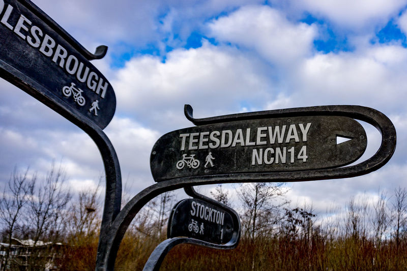 Beauty In Nature Capital Letter Close-up Cloud - Sky Communication Day Grass Guidance Information Nature No People Outdoors Road Sign Signboard Sky Street Name Sign Teesside Text Tree Western Script