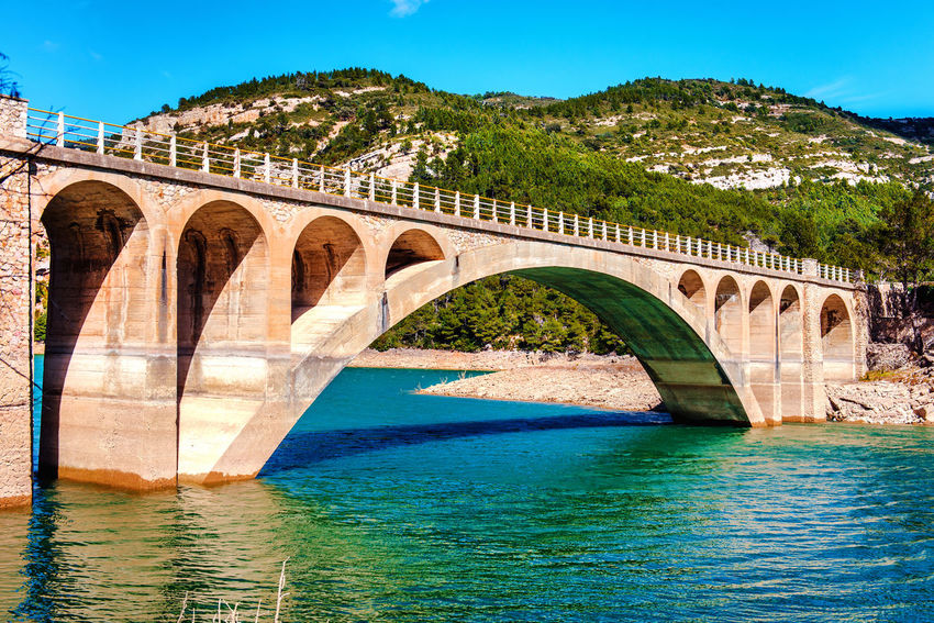View of the Ulldecona reservoir. Valencian Community, Spain Arched Bridge Architecture Bridge Bridge - Man Made Structure Europe Lake Landscape Mountain Nature Nobody Outdoors Reservoir Reservoir Dam River Rock Rock Formation Rocky Coast Rocky Mountains Scenery SPAIN Sunny Day Travel Destinations Ulldecona Water Waterside