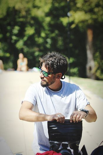 Man in sunglasses sitting outdoors