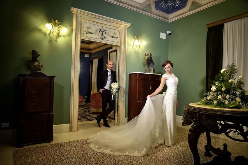Bride Wedding Dress Wedding Life Events Adults Only Only Women Anticipation Preparation  Bridal Shop Wedding Ceremony Indoors  Dedication Adult Young Adult Fitting Room Elégance People Standing Fashion Trying On