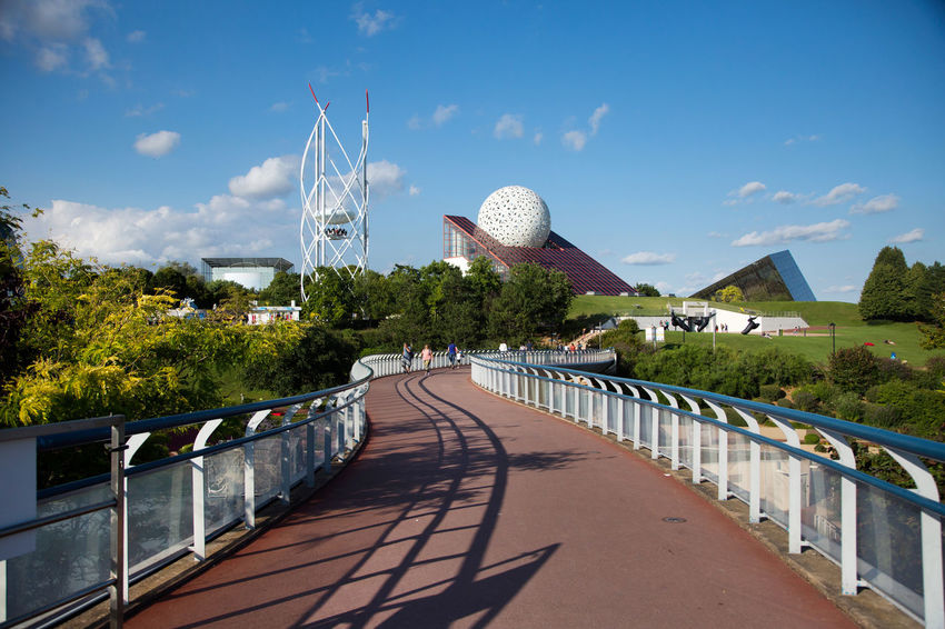 Futuroscope Theme Park Futuroscope Theme Park | Poitiers - France Futuroscope2017 Leisure Park Architecture Beauty In Nature Bridge - Man Made Structure Building Exterior Built Structure Cloud - Sky Connection Day Dome Nature No People Outdoors Railing Sky Sunlight Tree