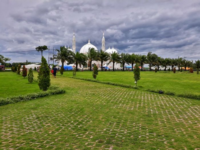 White Mosque Amazingindonesia Mosque Architecture Tree Field Sky Grass Green Color Cloud - Sky Landscape Grass Area Treelined
