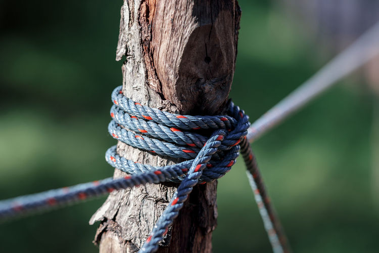 Rope tie between columns in garden, shallow depth of field