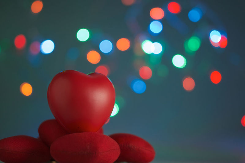 Close-up of heart shapes against defocused multi colored lights