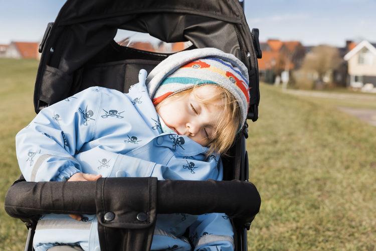 Cute Baby Girl Sleeping In Stroller