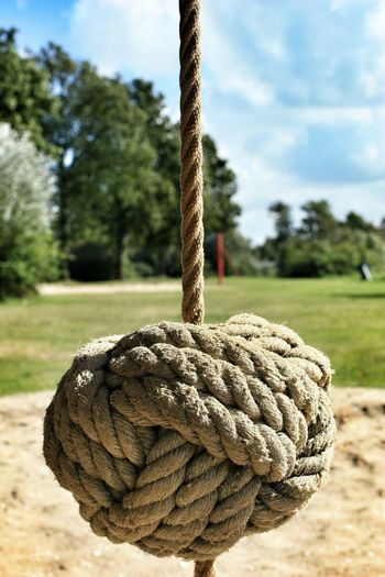 Close-Up Of Knotted Rope In Park