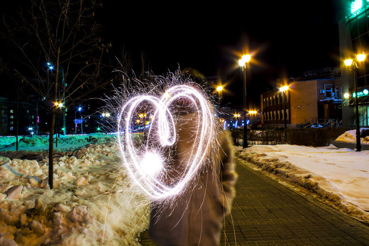 Illuminated Motion Arts Culture And Entertainment Long Exposure Winter Blurred Motion Sky Firework - Man Made Object Firework - Man Made Object Entertainment Wire Wool Smoke - Physical Structure Light Painting Spinning Emitting Glowing Firework Display Event Sparks Sparkler Firework Exploding Bauble