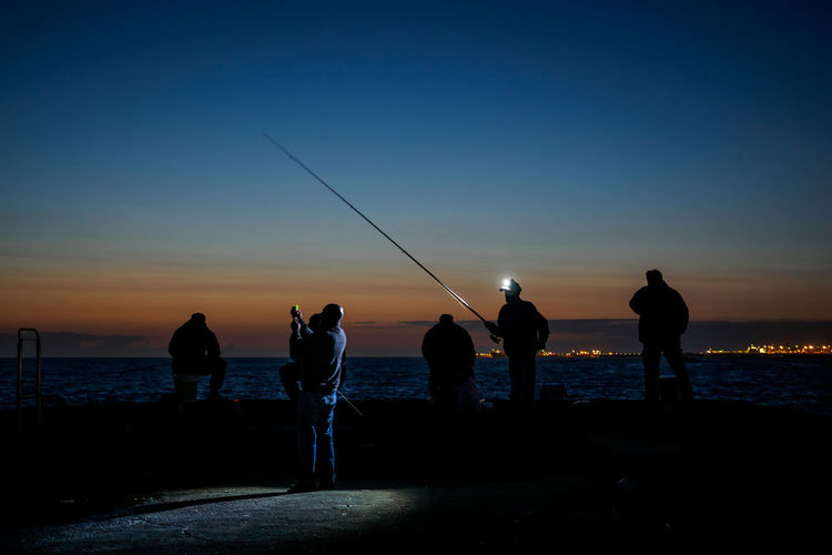 fisherman @ night Focus On The Story Stories From The City An Eye For Travel Beauty In Nature Fishing Fishing Pole Fivedaysporto Full Length Horizon Over Water Leisure Activity Lifestyles Men Nature Outdoors People Real People Scenics Sea Silhouette Sky Standing Sunset Togetherness Water Weekend Activities Breathing Space Your Ticket To Europe Connected By Travel The Great Outdoors - 2018 EyeEm Awards Capture Tomorrow