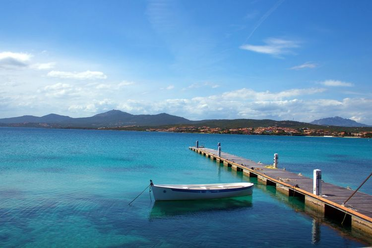 Bay Beauty In Nature Blue Cloud - Sky Day Mode Of Transportation Moored Mountain Nature Nautical Vessel No People Non-urban Scene Outdoors Scenics - Nature Sea Sky Tranquil Scene Tranquility Transportation Travel Turquoise Colored Water