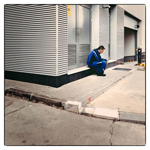 Smoke break in the morning hours Streetphotography Street Street Photography Streetphoto_color People People Watching Peoplephotography People Photography Business Modern Architecture