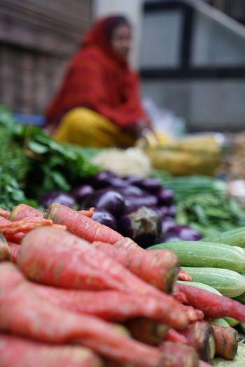 Abundance Adult Business Choice Consumerism Day Food Food And Drink Freshness Healthy Eating Large Group Of Objects Market Market Stall Marketplace One Person Raw Food Retail  Retail Display Selective Focus Variation Vegetable Wellbeing
