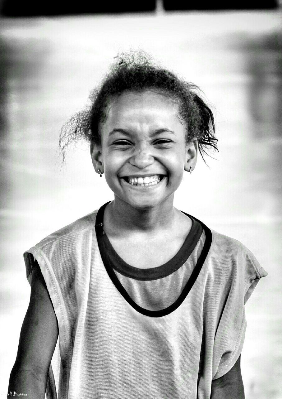 looking at camera, smiling, portrait, childhood, happiness, toothy smile, front view, one person, girls, cheerful, real people, day, outdoors, close-up, sky, people