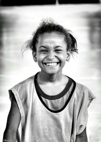 Portrait Looking At Camera Smiling Real People Happiness Lifestyles Cheerful Childhood One Person Close-up People Happiness Freshness Children Photography Social Documentary School Life  Black And White Leisure Activity Black & White Social Photography Relaxation Light And Shadow The Portraitist - 2017 EyeEm Awards