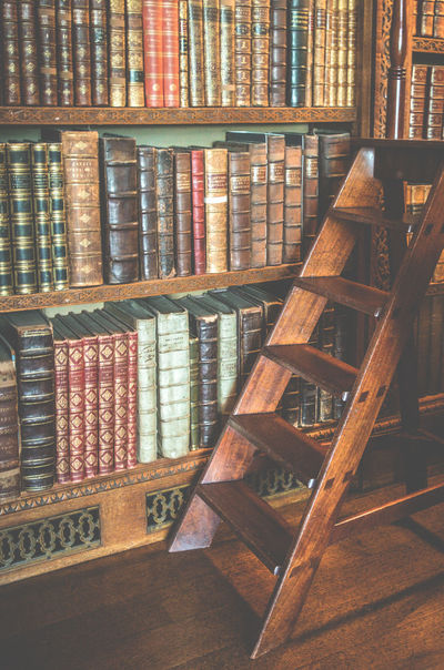 Image of the library at Charlecote Park. Charlecote Park Ladder Library Old Fashioned Way Reading Retro Wood Wooden Ladder Book Case Book Ladder Bookshelf Historical Indoors  Leather Bound Leather Bound Books National Trust No People Nt Polished Wood Step Ladder Study Wooden Floor