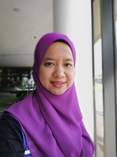 Portrait Of Smiling Mid Adult Woman Wearing Hijab At Home