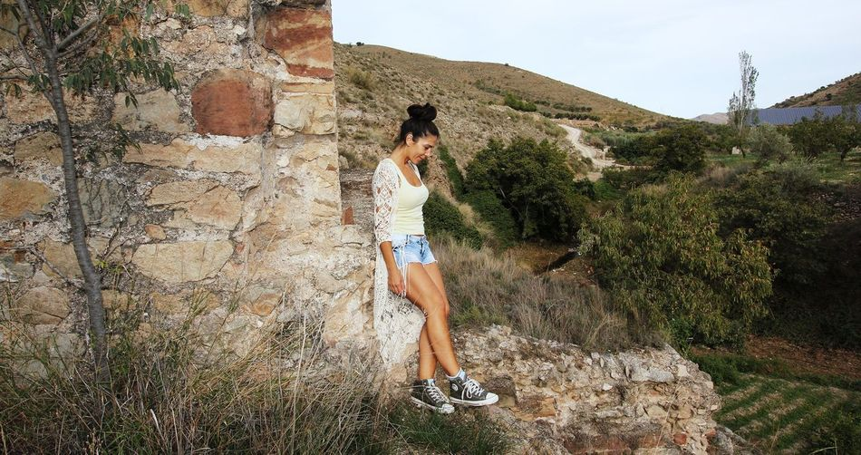 Women Women Beauty Beatiful Women Rock - Object One Person Real People Leisure Activity Full Length Casual Clothing Mountain Nature Outdoors Day Standing Lifestyles Side View Hot Pants Adventure Tree Young Adult Plant Scenics Landscape Young Women Beauty In Nature Grass Sky Adult People