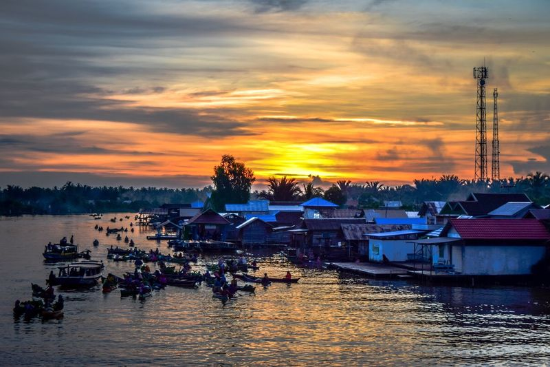Good Morning from Lok Baintan, Banjarmasin Sunset Nautical Vessel Water Transportation Boat Waterfront Mode Of Transport Moored Sky Cloud - Sky Cloud Orange Color Scenics Nature Tranquility Tranquil Scene No People Sea Beauty In Nature Passenger Craft Sunrise Banjarmasin Lokbaintan