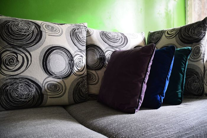 Comfort. Indoors  No People Day Close-up Interior Comfort Cozy Furniture Design Sofa Relax Cushion Pattern Retro Design Colors Cold Colours Light And Shadow