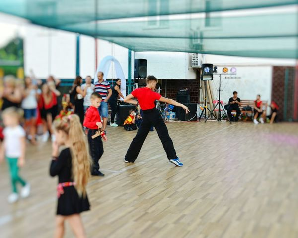 Sport Exercising Sports Clothing Healthy Lifestyle Lifestyles Sportsman Dance Floor Ballroom Dancing Young Men Dance Dancing Motion Athlete Young Adult Large Group Of People Leisure Activity Dancer Music Women People Coach Young Women Real People Teamwork Togetherness