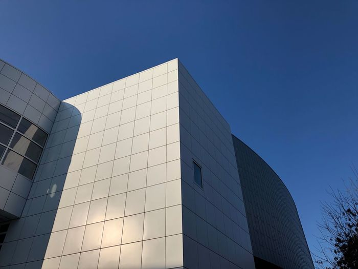 What's the point? Minimalist Modern Geometric Shapes Architecture Built Structure Building Exterior Modern Sky Clear Sky Blue