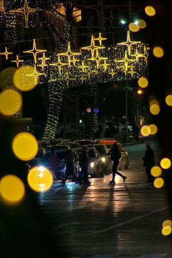 Vehicles on illuminated city at night